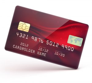 Vector illustration of detailed glossy red credit card isolated on white background